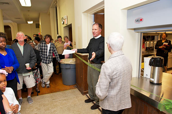 Fr. David speaks to those gathered for the blessing of the renovated kitchen.