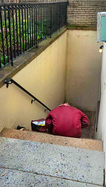 Homeless woman sheltering in place in a stair well at our church on Palm Sunday. Friendship House, as always, still offers beds inside our church to sixteen homeless men..